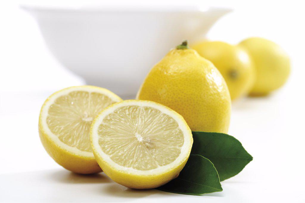 Lemons in front of bowl : Stock Photo