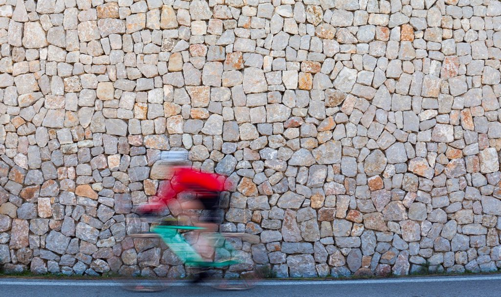Stock Photo: 1815R-138915 Spain, Mallorca, Cyclist cycling on street at Estellencs
