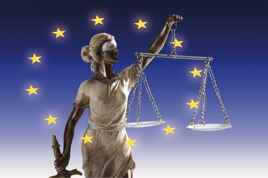 Justitia figurine in european flag, close-up : Stock Photo