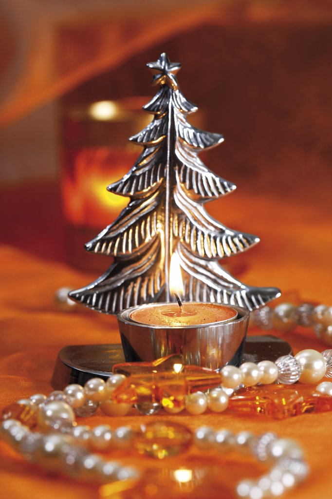 Silvery christmas tree candle holder with tealight : Stock Photo