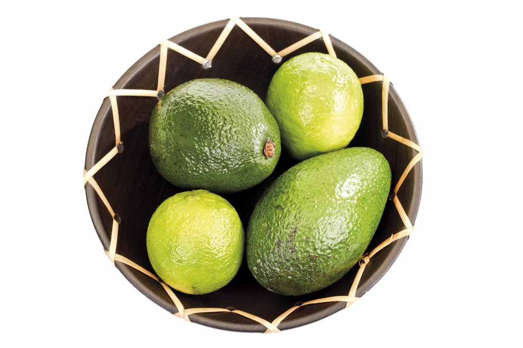 Avocado and Limes in bowl : Stock Photo