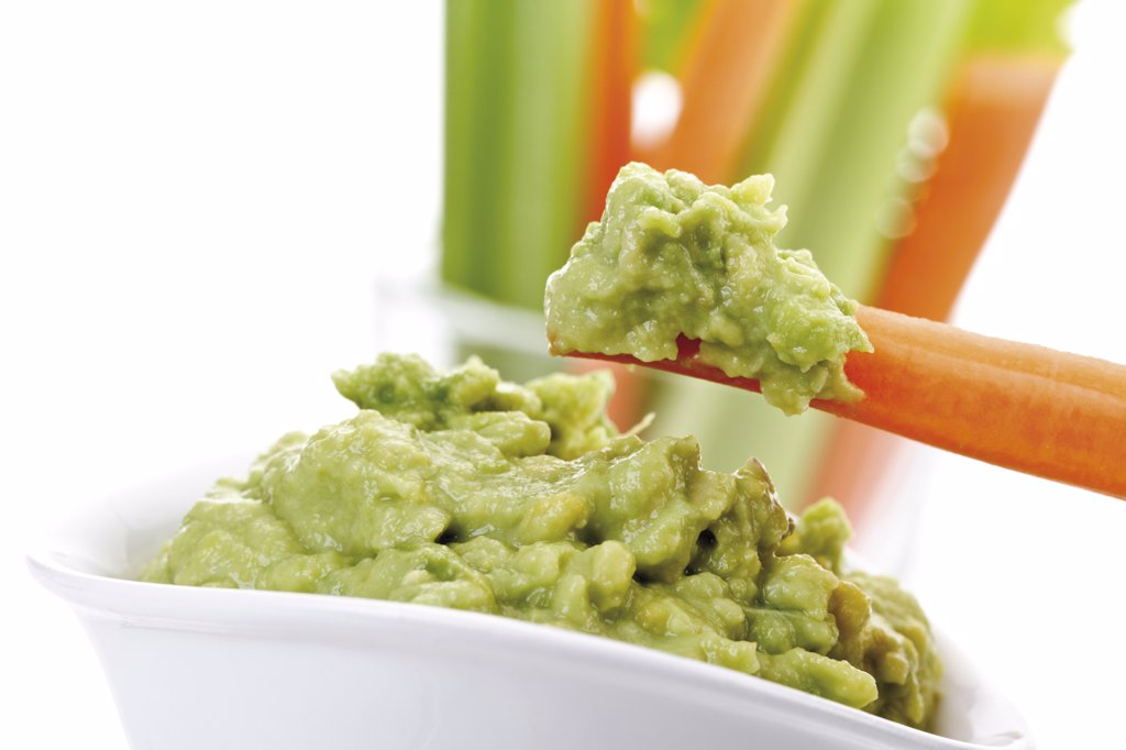 Guacamole with vegetable sticks : Stock Photo