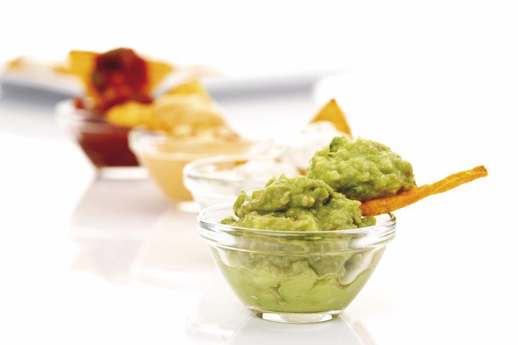 Tortilla Chips with avocado dip : Stock Photo
