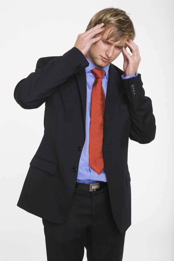 Stock Photo: 1815R-17337 Young businessman with hands to head