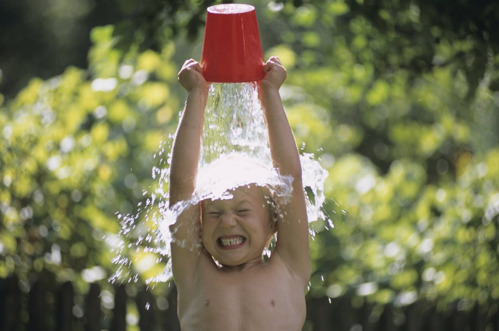 Stock Photo: 1815R-17941 Boy pouring water over head, outdoors