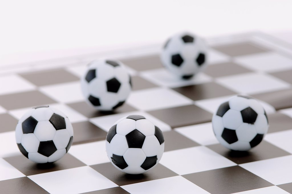 Footballs on a chessboard : Stock Photo