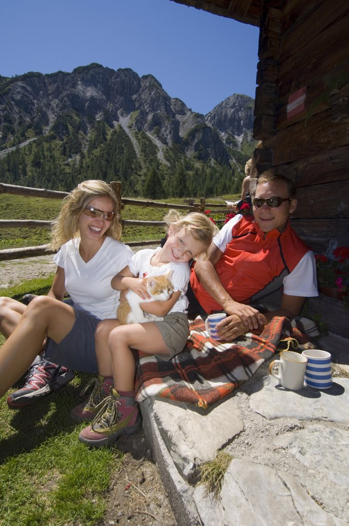 Austria, Salzburger Land, couple with daughter (6-7) taking a break : Stock Photo