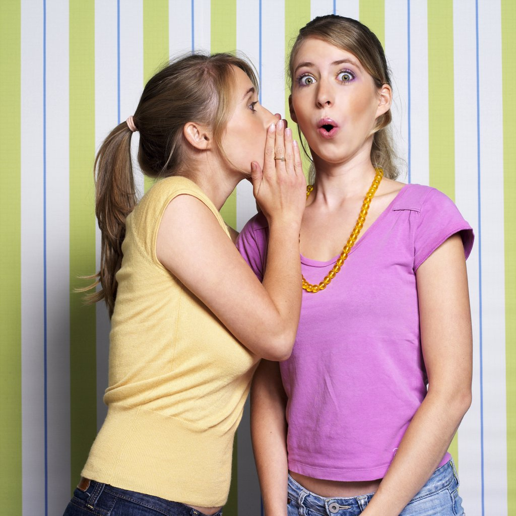 Teenage girls (16-17) whispering, portrait : Stock Photo