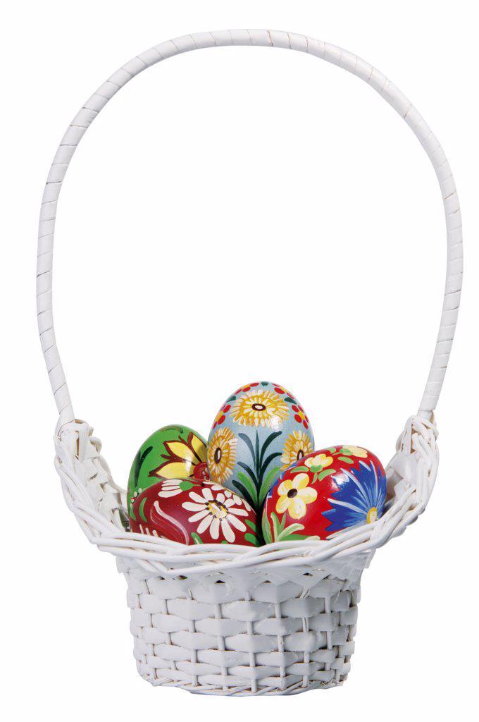 Easter eggs in white basket : Stock Photo
