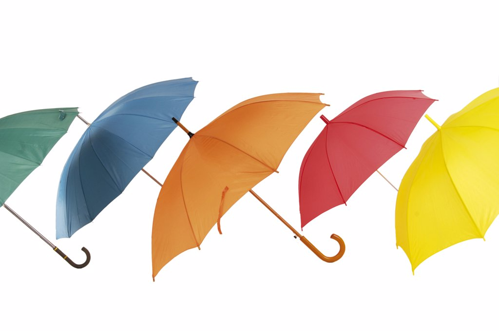 Various umbrellas in a row : Stock Photo
