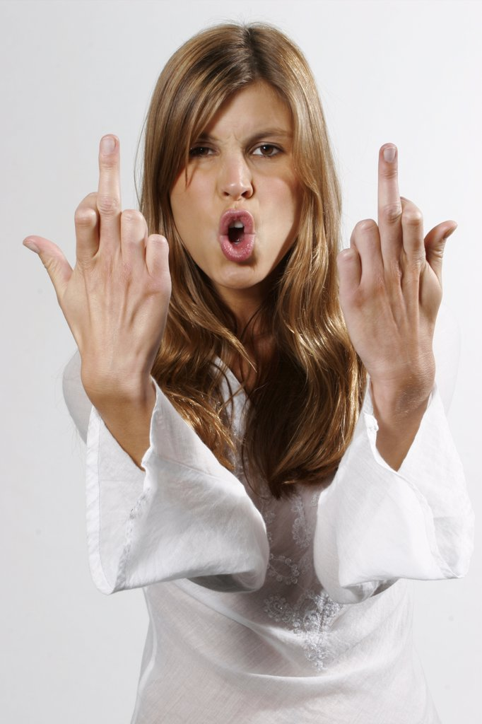 Stock Photo: 1815R-20736 Young woman making obscene hand gesture , portrait