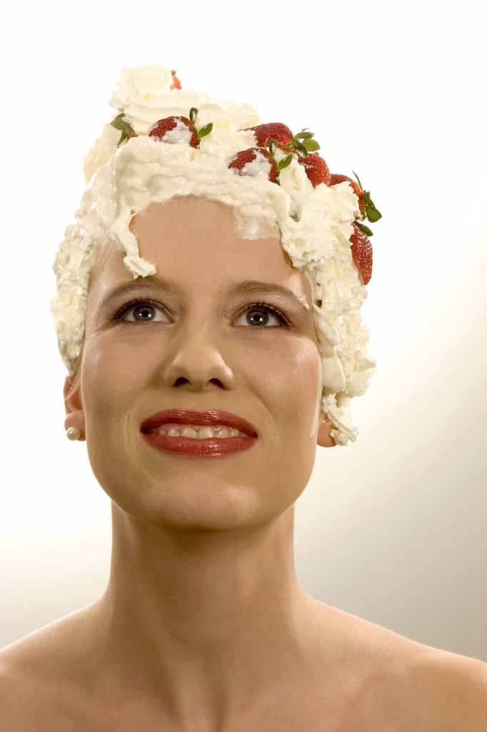 Young woman with cream on head, close-up : Stock Photo