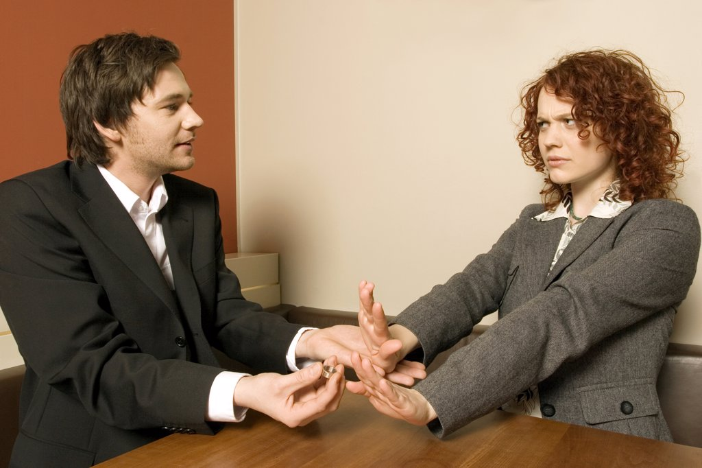 Woman rejecting wedding ring from man : Stock Photo