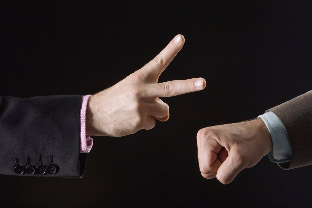 Businessmen playing rock paper scissors, close-up of hands : Stock Photo