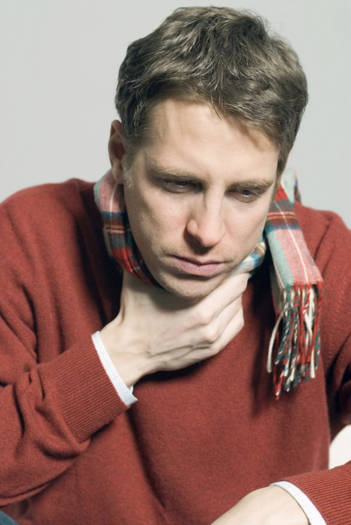 Man with a sore throat : Stock Photo