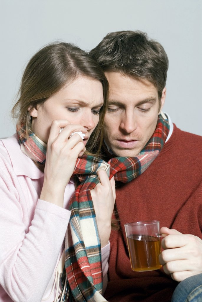 Stock Photo: 1815R-22727 Young couple with a cold drinking tea