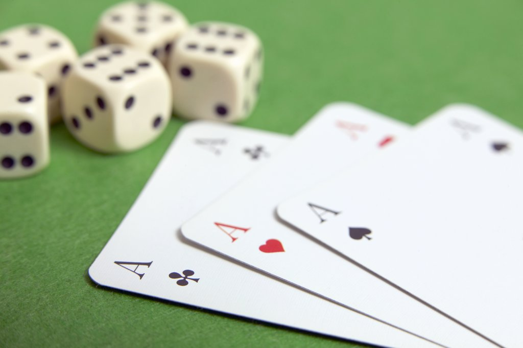 Stock Photo: 1815R-23003 Dice and three aces, close-up