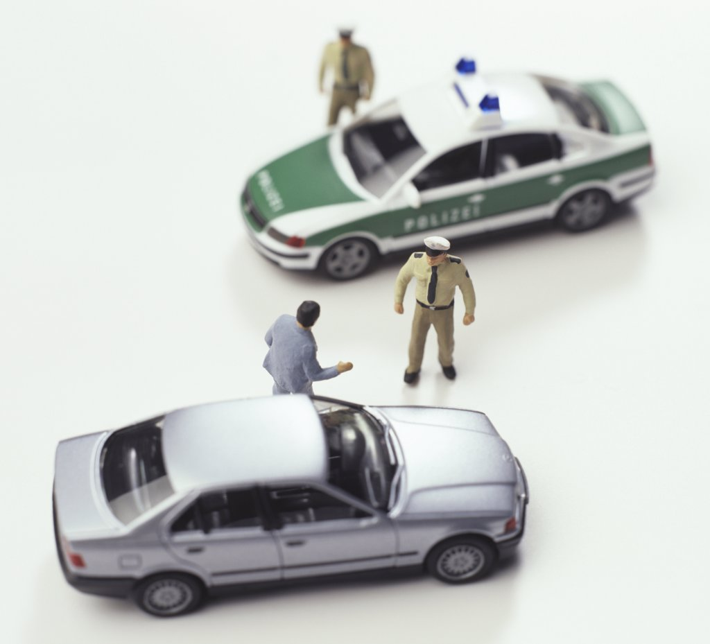 Figurines and toy cars : Stock Photo