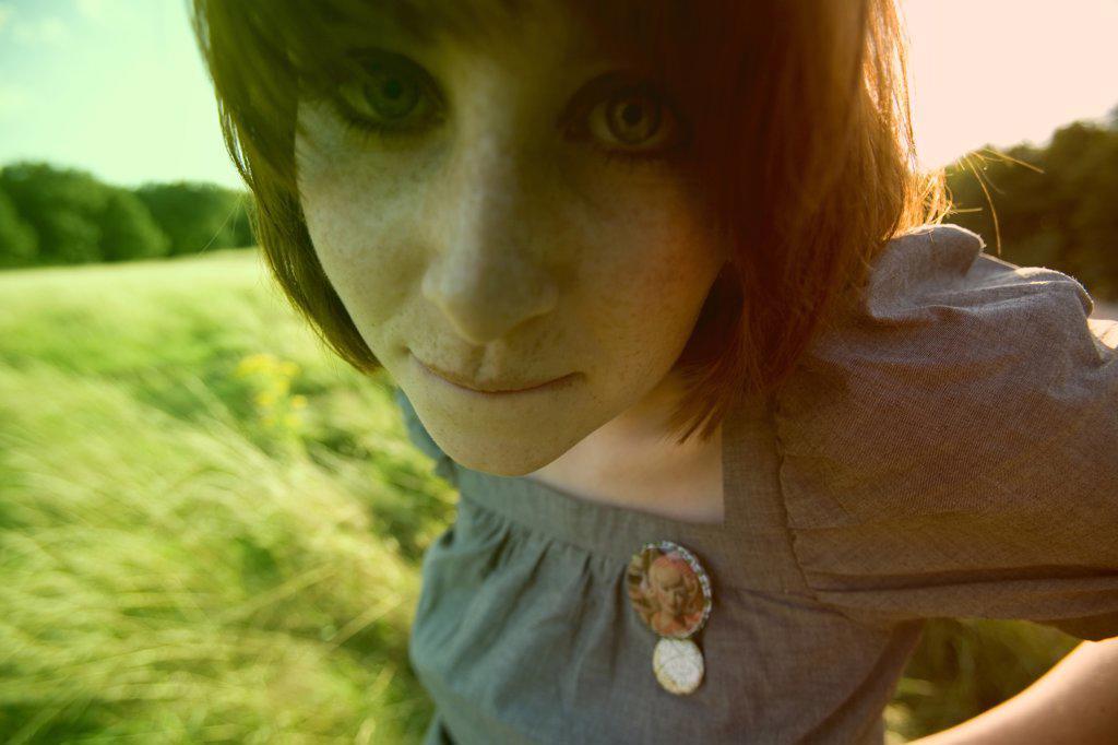 Red headed woman in corn field, portrait : Stock Photo