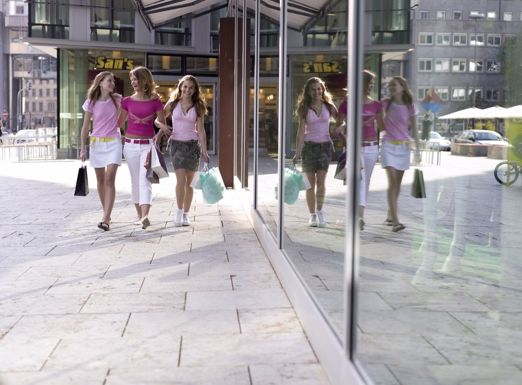 Teenage girls (16-17) walking with shopping bag : Stock Photo