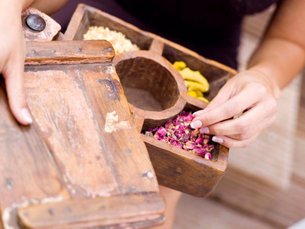 Woman holding spice box, mid-section : Stock Photo