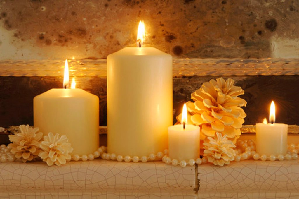Burning candles with fir cones on shelf, close-up : Stock Photo