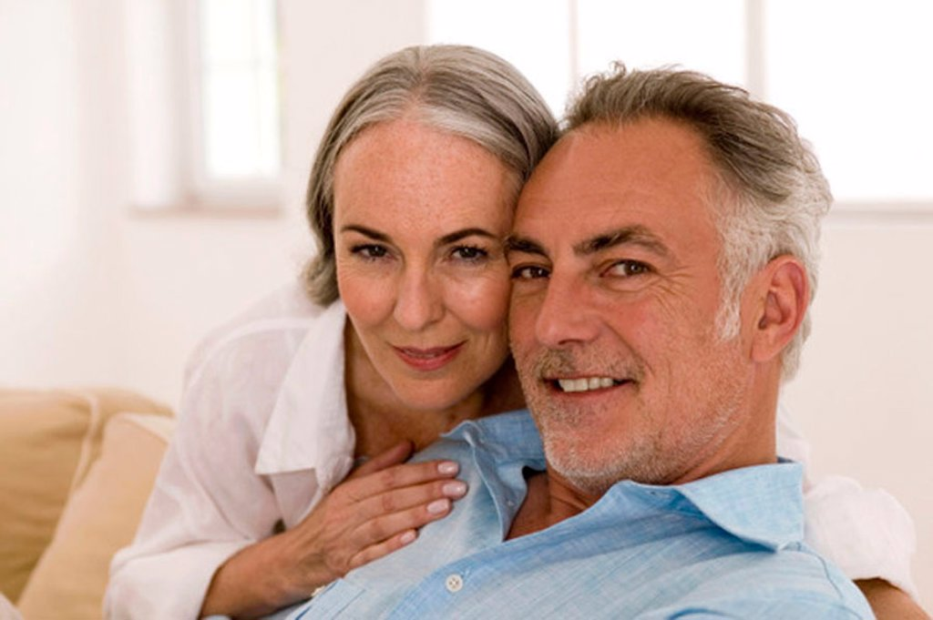 Mature couple in living room, close-up, portrait : Stock Photo