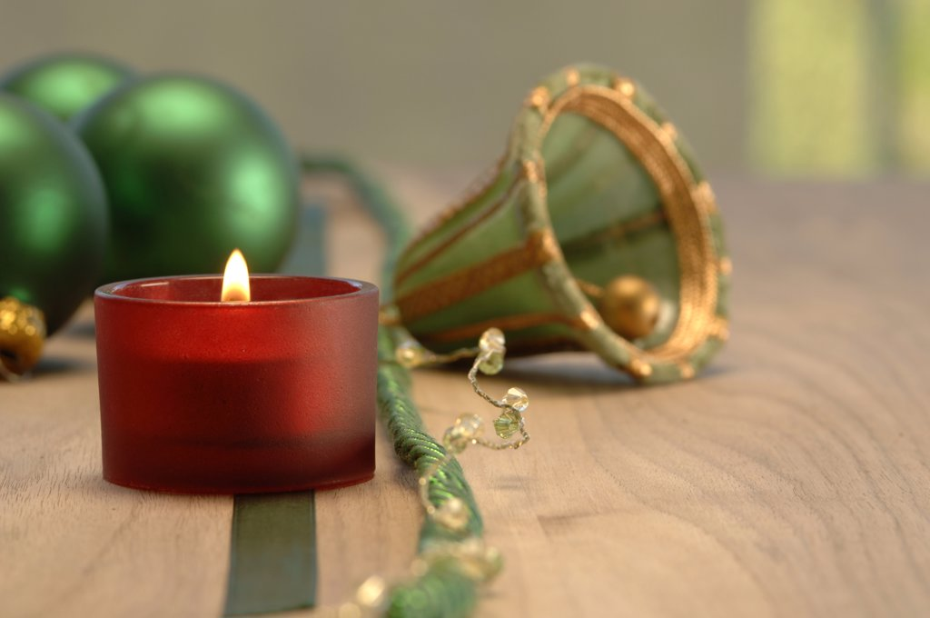 Christmas decoration with burning candle and christmas baubles : Stock Photo