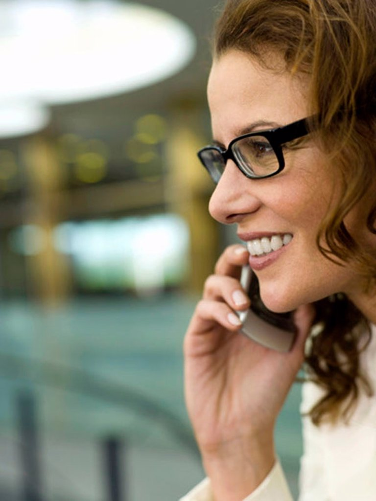 Businesswoman using mobile phone : Stock Photo