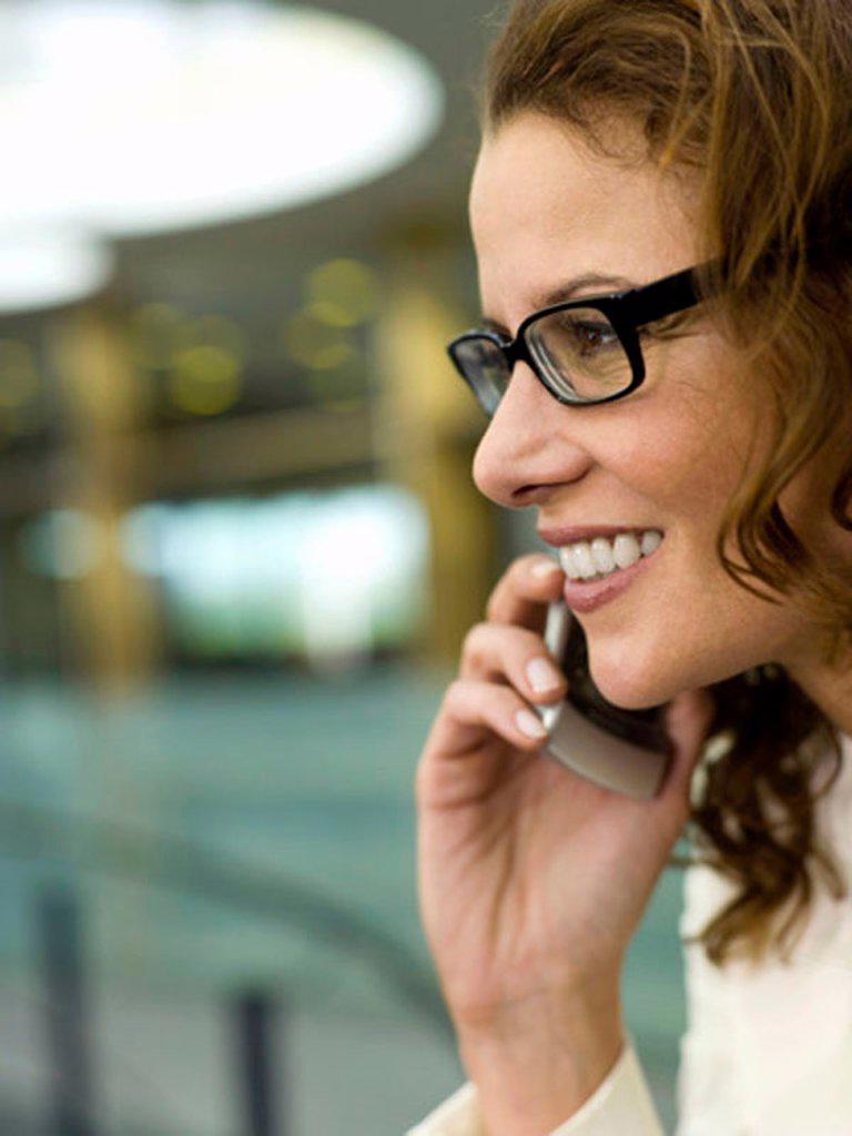 Stock Photo: 1815R-26646 Businesswoman using mobile phone