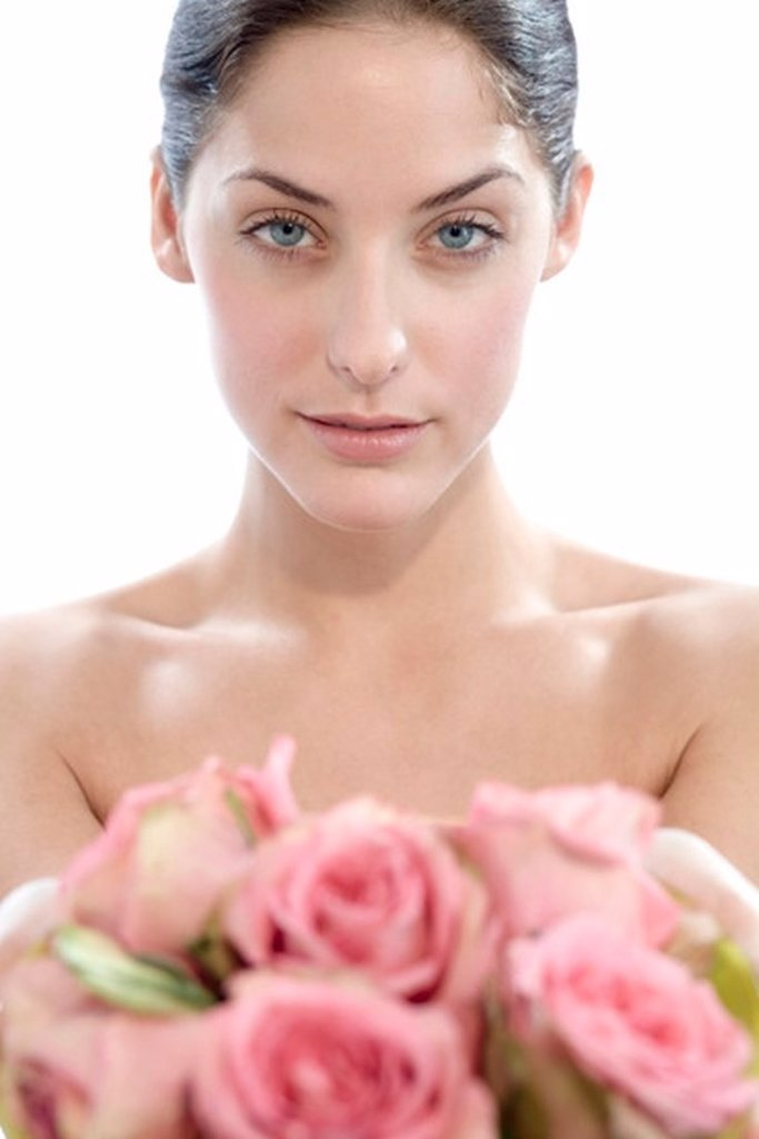 Young woman holding rose flowers, portait : Stock Photo