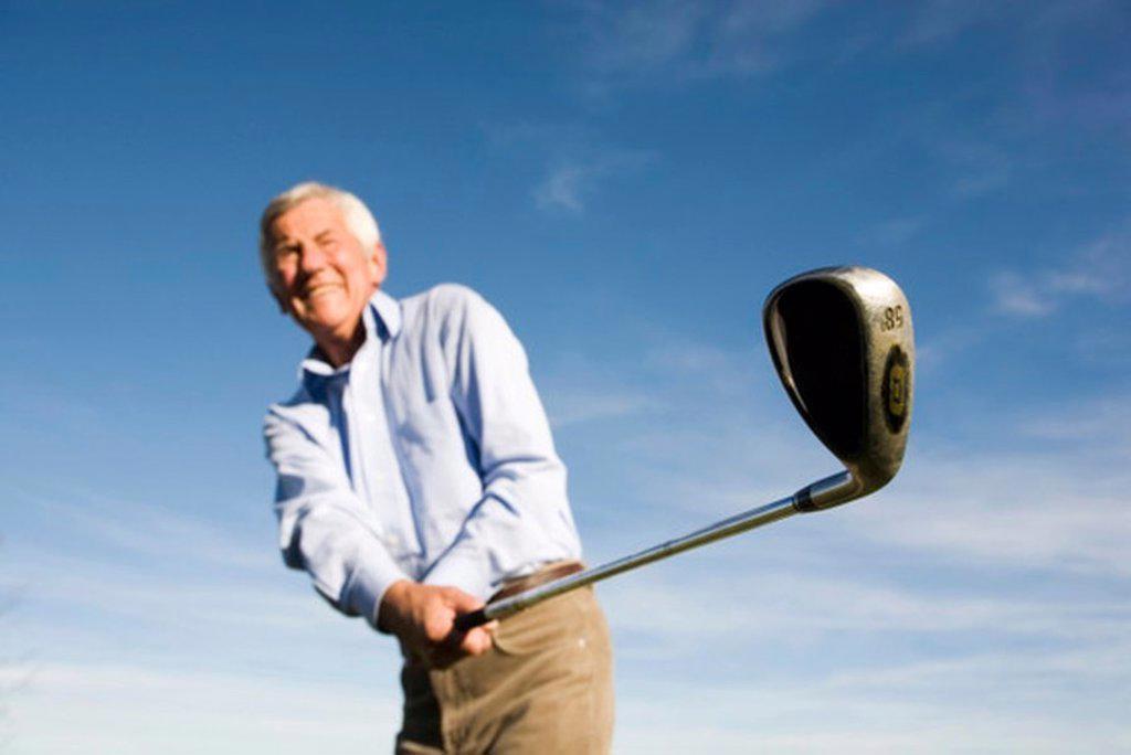Senior adult man holding golf club : Stock Photo