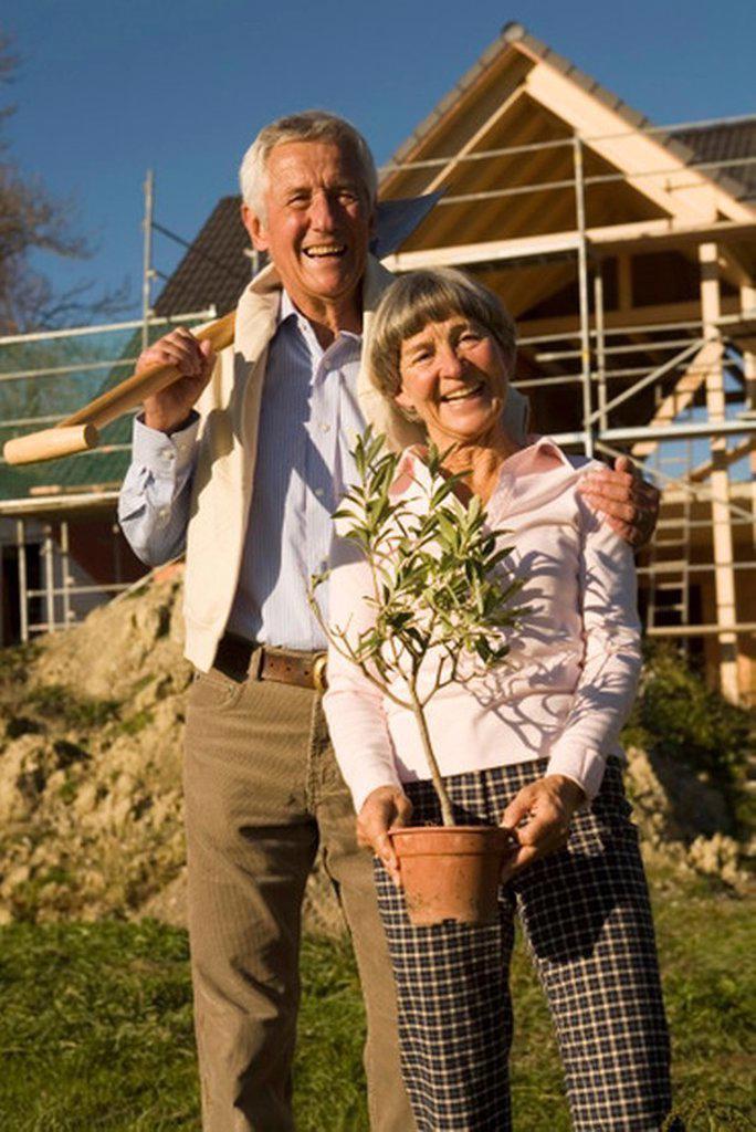 Senior couple gardening, smiling, portrait, low angle view : Stock Photo