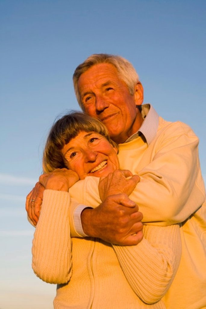 Senior couple embracing, portrait : Stock Photo