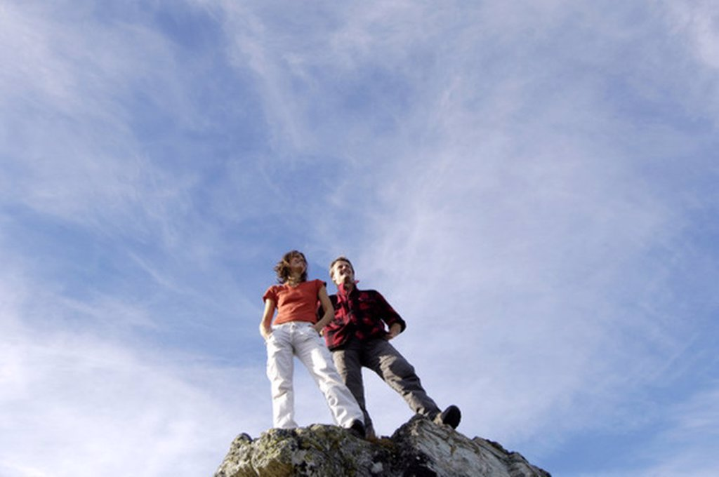 Couple standing on summit : Stock Photo