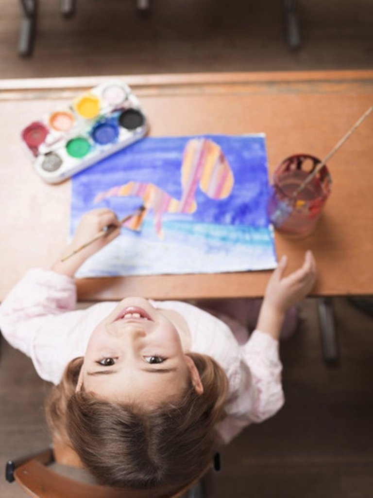 Stock Photo: 1815R-28151 Girl painting with water colours