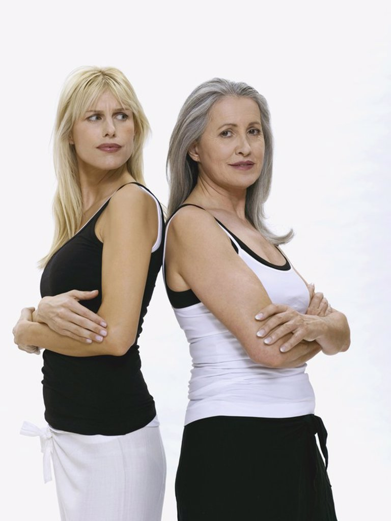 Mother and daughter, back to back : Stock Photo