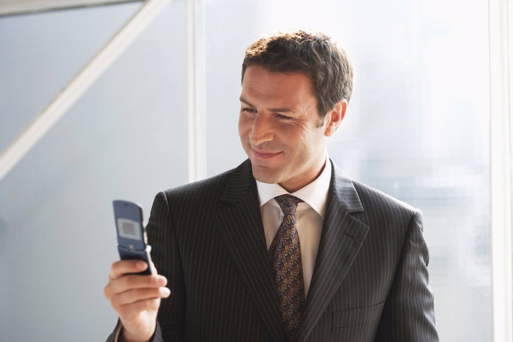 Business man, using mobile phone, close-up : Stock Photo