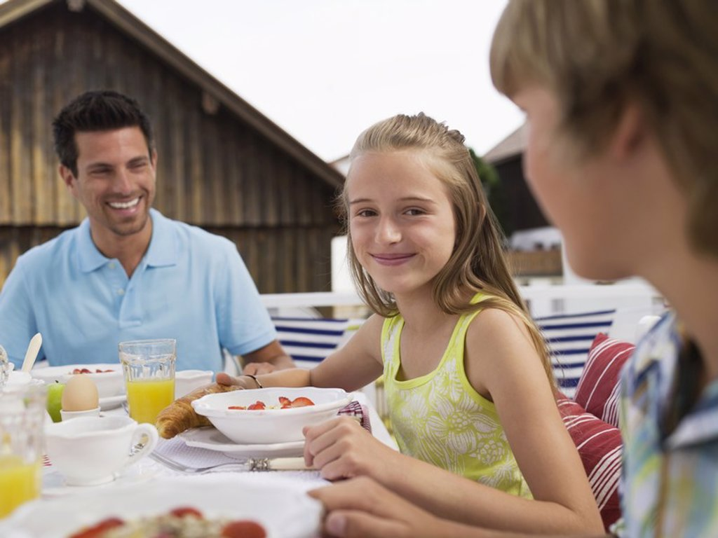 Stock Photo: 1815R-29579 Family at breakfast table