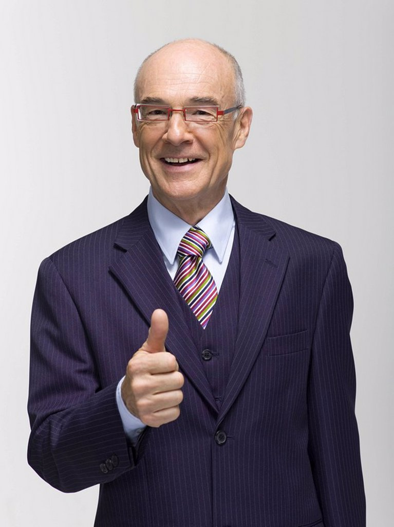Businessman making hand gesture, portrait : Stock Photo