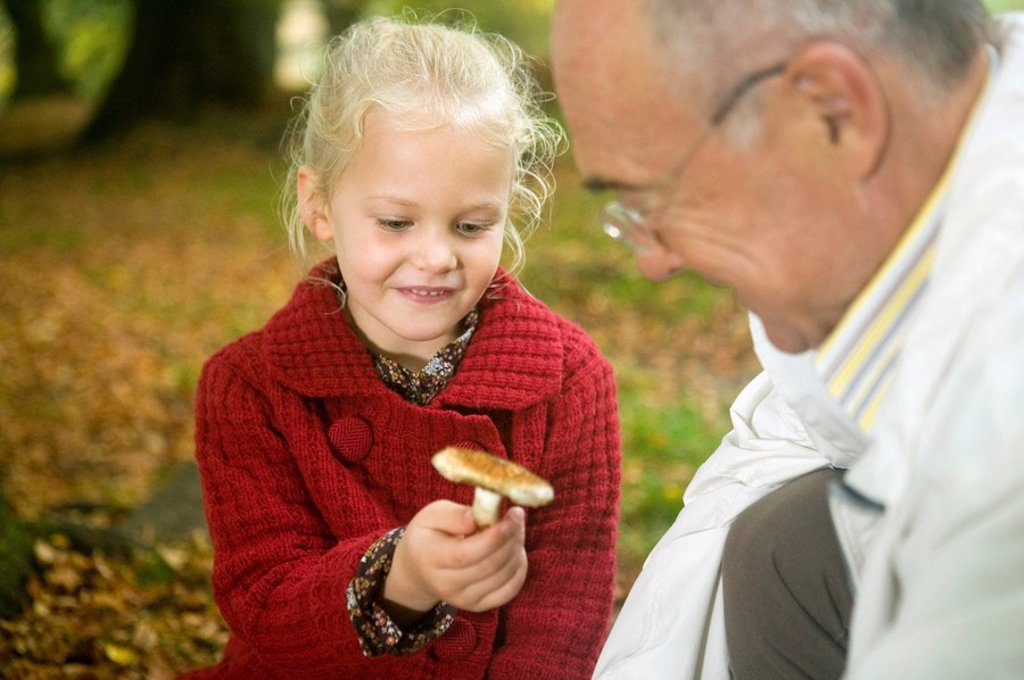 Stock Photo: 1815R-29718 Germany, Baden-Württemberg, Swabian mountains, Grandfather and granddaughter searching mushrooms in the forest, portrait