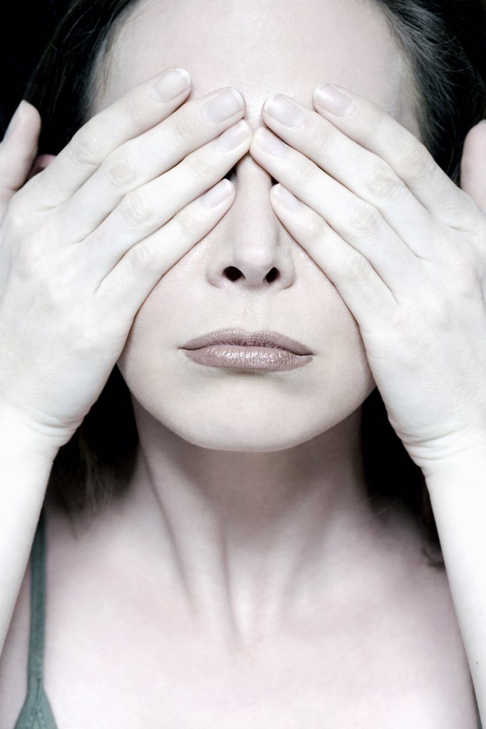 Young woman, portrait, hiding eyes : Stock Photo
