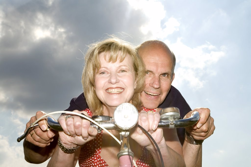 Mature couple riding bike : Stock Photo