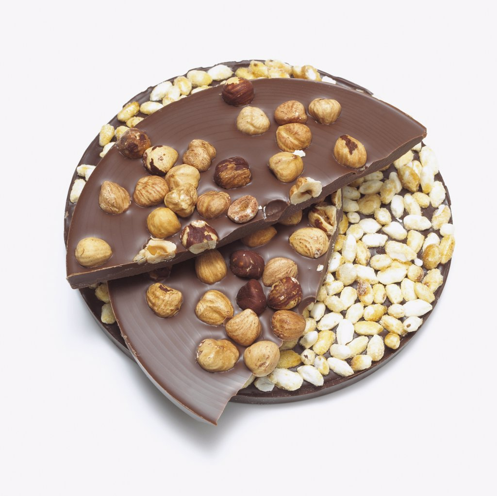 Chocolate with nuts and puffed rice, close-up : Stock Photo