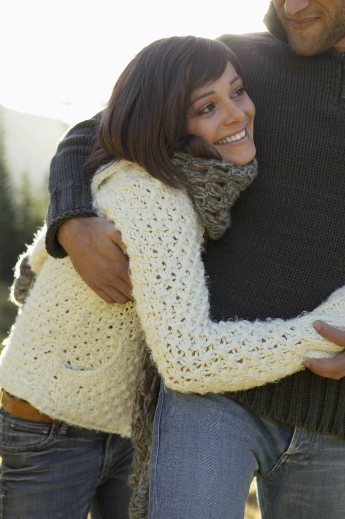 Young couple embracing, close-up : Stock Photo