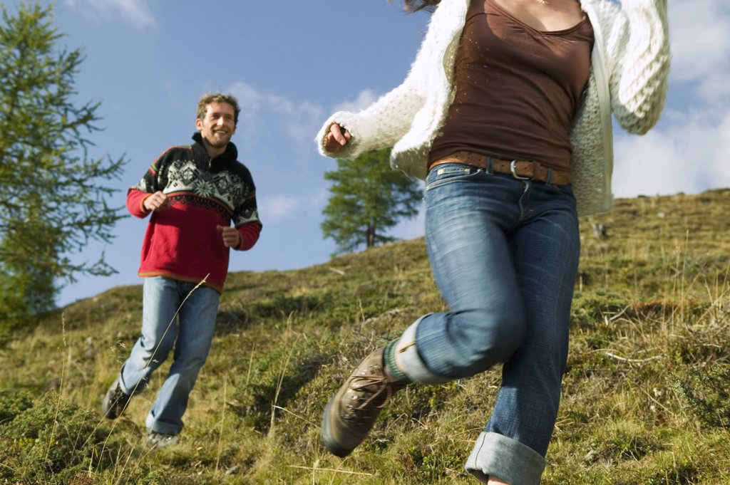 Young couple running in mountains : Stock Photo