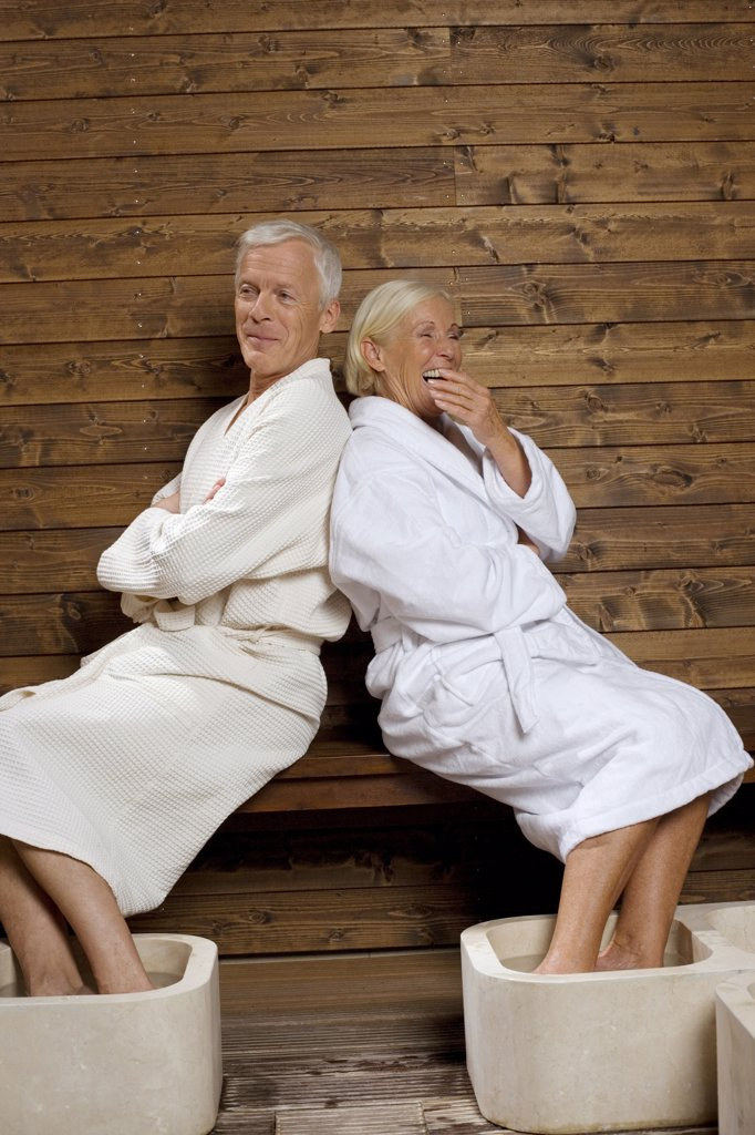 Germany, Senior couple wearing bath robes : Stock Photo