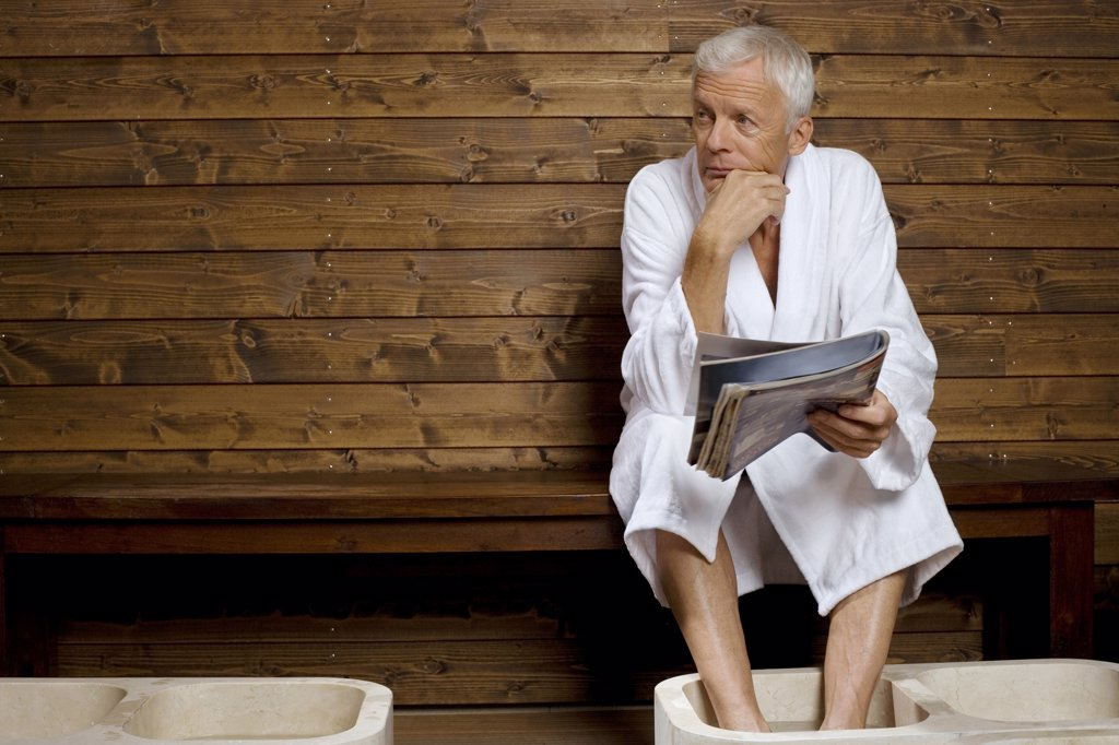 Germany, senior man having foot bath in health spa : Stock Photo