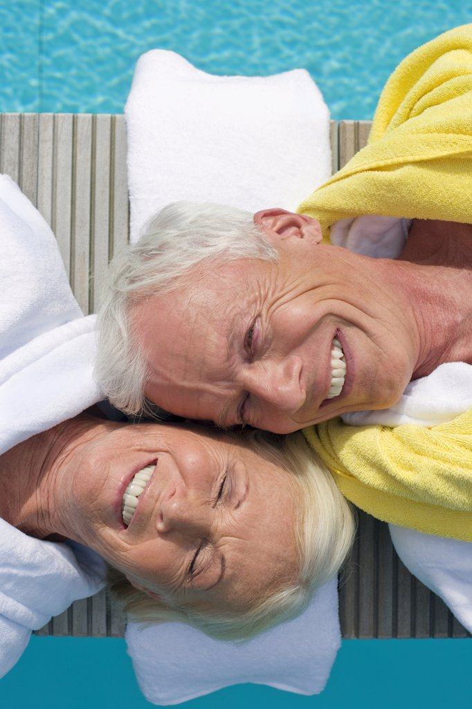 Germany, Senior Couple Relaxing on jetty : Stock Photo