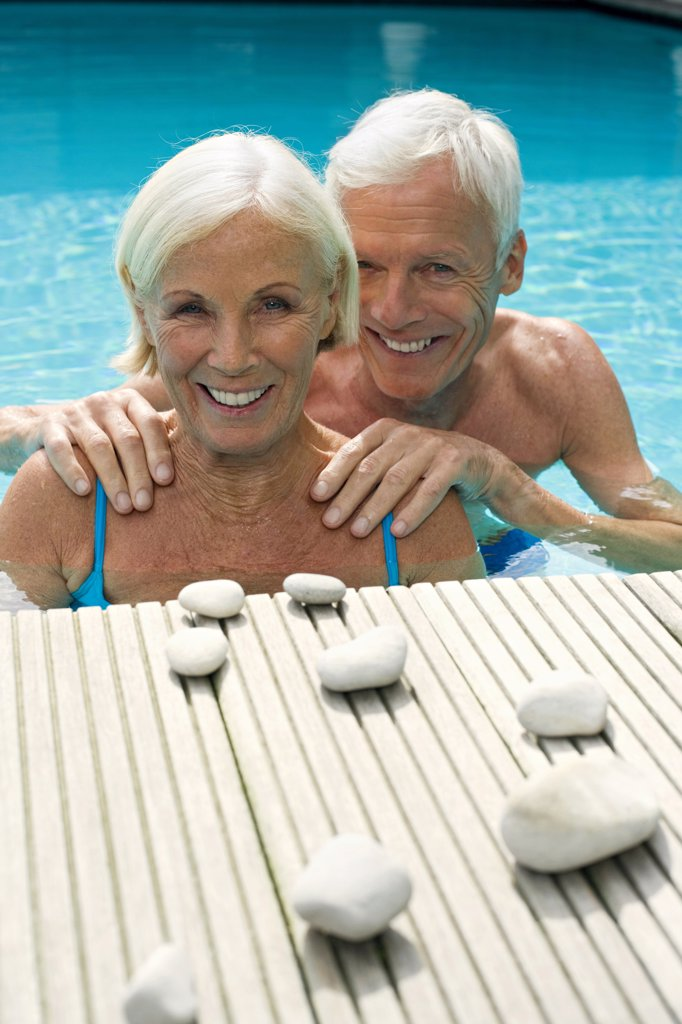 Stock Photo: 1815R-33644 Germany, Senior couple in pool, close-up